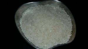 Raw rice or kaccha chawal .